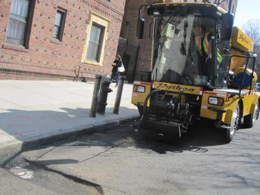 The Python Pothole Patcher meets its pothole foe on 34th Road in Queens.
