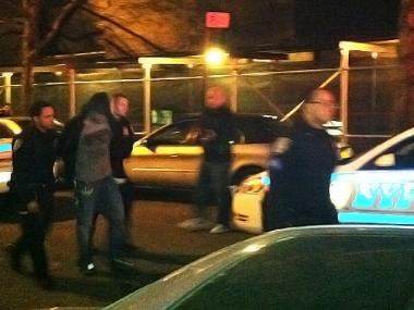 A suspect is arrested for an alleged break-in on 187th Street and Cabrini Boulevard on March 19, 2012.