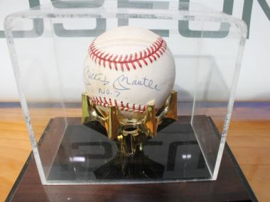 A baseball signed by Mickey Mantle is one of many artifacts that will be on view at the