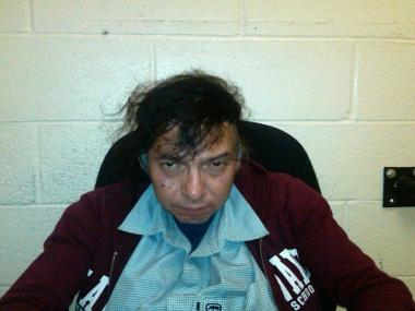 Armondo Calderon, 56, is being charged with setting 15 fires in trash cans in Midtown, fire officials said.