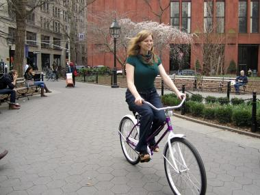 NYU senior Kayla Santosuosso, 21, rides one of the new bikes in Washington Square Park March 21, 2012.