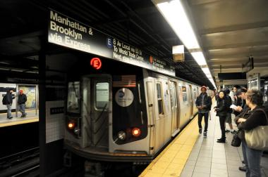 A man was found unconscious in a downtown E train.