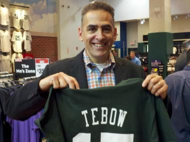 Jeff Schneiderman, 50, came to the Modell's in Times Square on Friday, March 23, 2012, to buy a Tebow T-shirt for his son.