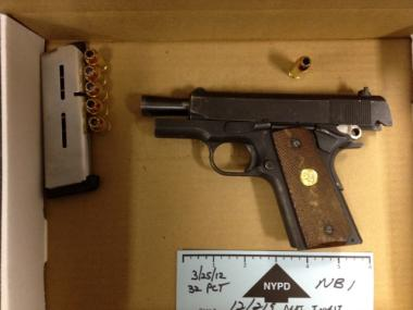 Police recovered a .45 caliber Colt 1911 handgun that was loaded with several bullets from the scene of a police-involved shooting on Frederick Douglass Boulevard on March 25, 2012.