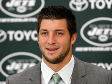 FLORHAM PARK, NJ - MARCH 26: Quarterback Tim Tebow addresses the media as he is introduced as a New York Jet at the Atlantic Health Jets Training Center on March 26, 2012 in Florham Park, New Jersey. Tebow, traded from the Denver Broncos last week, will be the team's backup quarterback according to Jets head coach Rex Ryan. Tebow, the 2007 Heisman Trophy winner, started 11 games in 2011 for Denver and finished with a 7-4 record as a starter. He led the Broncos to a playoff overtime win against the Pittsburgh Steelers in the first round before eventually losing to the New England Patriots in the next round. (Photo by Jeff Zelevansky/Getty Images)