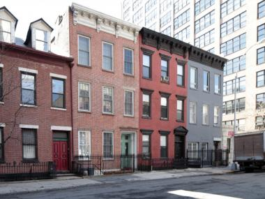 The three buildings on the left, located on Dominick Street in Hudson Square, were designated as landmarks on March 27, 2012. The building on the right had already been altered too much to be landmarked, the LPC said.