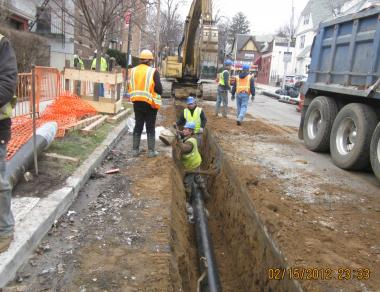 City crews work on a water main on Beverly Street between Brevoort Street and Lefferts Boulevard in Kew Gardens in February.