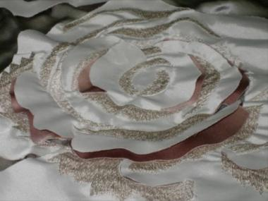 A machine-embroidered rose design made by Cortes.