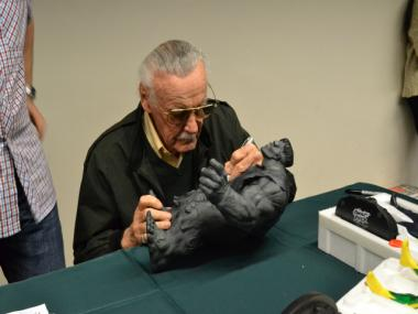 Famed comic book illustrator Stan Lee autographs a model of the Incredible Hulk at the Annual One Day Comic Book Show on Saturday, Mar. 31, 2012.
