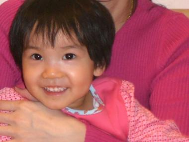 Four-year-old Grace, in her mother Renee Tang Kong's arms, does not speak.