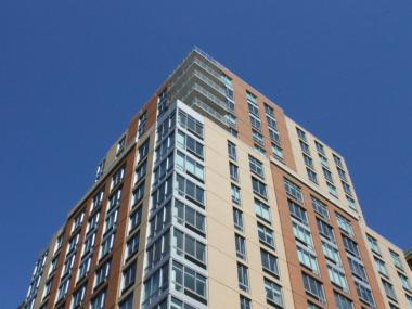The 22-story Elliot-Chelsea development has apartments for low- and middle-income tenants.
