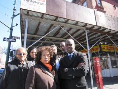 Residents at 123rd Street and Lenox Avenue say the scaffolding has been in place for 8 years, attracting crime and loitering,  but no work is being done on the landmarked building at 260 Lenox Ave.