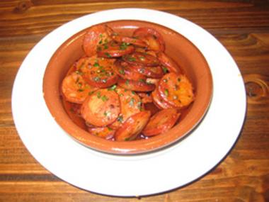 Chorizo al Jerez is made with smoked cured Spanish chorizo sautéed in Jerez wine for $8.