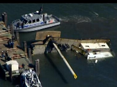 A spud barge capsized at Liberty Island April 6, 2012.