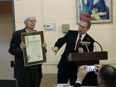 Manhattan Borough President Scott Stringer, left, hands departing CB4 member Ed Kirkland a plaque declaring April 4, 2012,