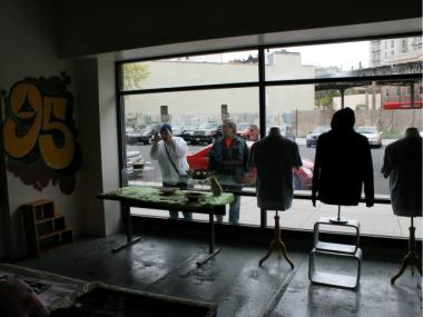Passersby stop to stare at a new hip-hop pop-up shop inside the Intervale Green housing development at 1303 Louis Nine Blvd.