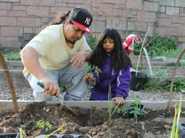 Calletano Reyes, who grew crops on a farm in his native Mexico, has taught his daughter, Ruby, how to work the land in the Bronx.
