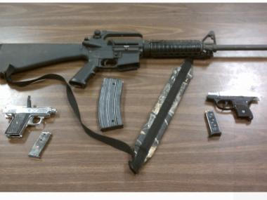Narcotics detectives found three automatic weapons during a routine traffic stop in Jamaica, Queens, on April 11, 2012.