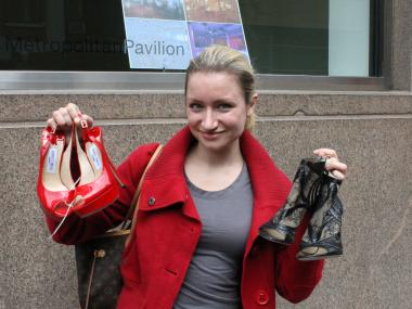Maria Couture, 28, shows off two of the twenty pairs of shoes she bought at the Jimmy Choo sample sale on April 12, 2012.