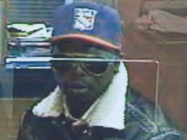 Cops are searching for a man who robbed a Sovereign Bank at 51st Street and Eighth Avenue Weds., April 13, 2012.