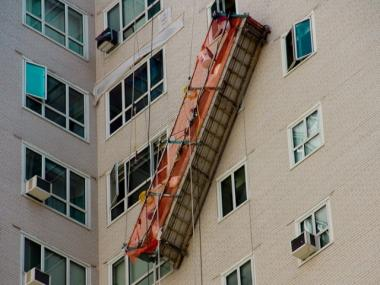 Three men were rescued from a dislodged scaffolding at 200 East 65th Street on April 13, 2012.