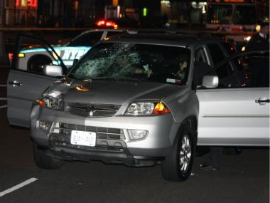 An off-duty NYPD worker was charged with drunk driving after striking and killing a man in Harlem on Sun., April 15, 2012.
