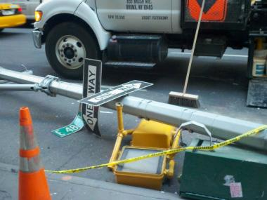 A downed traffic light at the scene of a collision between a cab and tractor-trailer at the corner of East 48th Street and Lexington Avenue early Tuesday, April 17, 2012.