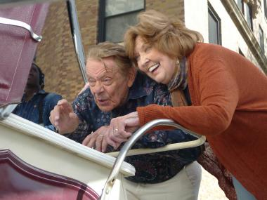 Jerry Stiller and Anne Meara make their best googly eyes at an imaginary infant in a baby carriage while filming a public service announcement for the city's MillionTreesNYC initiative.