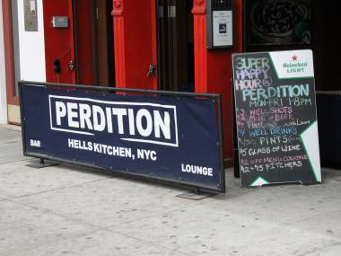 A bouncer was assaulted with a slab of concrete by three jilted bar-goers at Perdition, cops said.