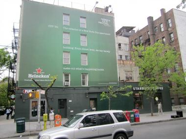 The trees would have blocked two out of three lines of text on a four-story billboard advertising Heineken and the Tribeca Film Festival.