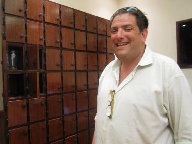 Doug Soclof, of the Coffee Bean & Tea Leaf, stand with the shop's new lockers, which will be launched soon for regulars who want to keep their mugs at the store.