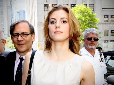 Jaynie Baker leaves Manhattan Supreme Court with lawyer Robert Gottlieb on April 20, 2012.