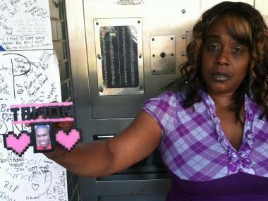 Ladongula Wyatt holds a picture of her nephew Tamon Robinson who died after being struck by a police car on April 12, 2012.