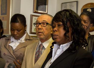 Laverne Dobbinson, right, spoke about her son, Tamon Robinson, at a press conference at the law office of Sanford Rubenstein, center, on April 24, 2012.