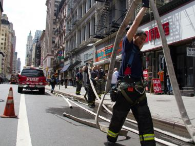 Firefighters battled a blaze at a shoe store at 391 Broadway on April 25, 2012.