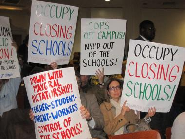 Advocates protested the school closures ahead of the panel vote.