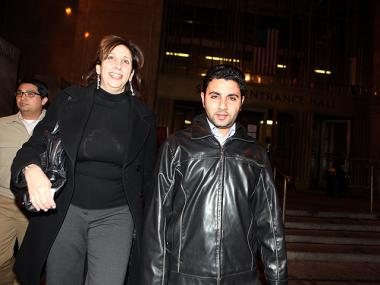 Teacher's aide Hany Abdalla (r.) walks out of Manhattan Criminal Court with his lawyer Virginia LoPreto Thurs., April 26, after sex abuse charges were dropped.