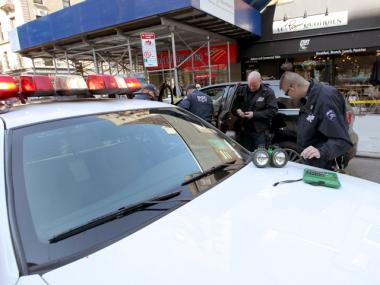NYPD officers investigate an unrelated crime scene Apr. 28th, 2012.