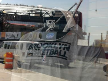 The Brooklyn Nets' new logo was unveiled at a Modell's sporting goods store across the street from the Barclays Center, where they will play.