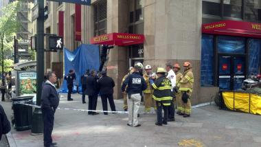 Authorities set up a blue tarp at Wells Fargo at 180 Madison Avenue after the discovery of a suspicious substance there on April 30, 2012.