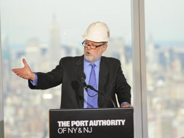 Port Authority Executive Director Patrick Foye speaks at 1 World Trade Center on April 30, 2012, the day the building became the tallest in New York. The Empire State Building, which it eclipsed, is in the background.