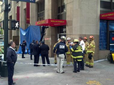 Authorities set up a blue tarp at Wells Fargo at 180 Madison Ave. after the discovery of a suspicious substance there on April 30, 2012.