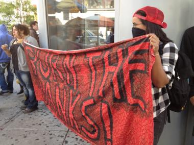 "Protesters held a sign that read ""Burn the Banks!"" on May 1, 2012."