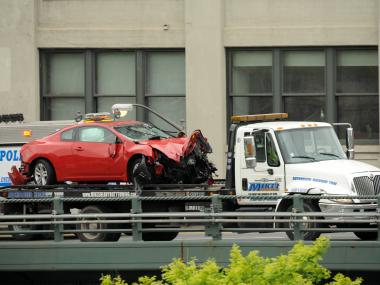 A car flipped on the BQE at Tillary Street near the Brooklyn Bridge, injuring one, on Weds., May 2, 2012.