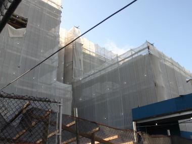 P.S. 29 shrouded by netting during construction.