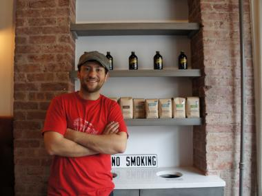 Owner Murat Uyaroglu shows off his array of Stumptown coffees at the new Prospect Heights cafe Hungry Ghost.