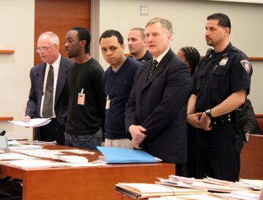 Dominick Davis and Alejandro Campos (second and third from left, respectively) were arraigned on April 27, 2012, on charges they killed Hwang Yang over his iPhone.