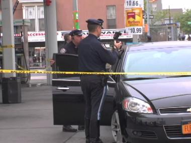 Cops inspect the car that fatally struck Maria Tripp, 47, on Ralph and Atlantic avenues on May 3, 2012.