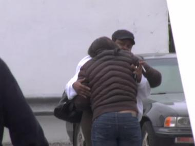 Mourners embrace at the scene of an accident on Ralph and Atlantic avenues where Maria Tripp, 47, was killed on May 3, 2012.
