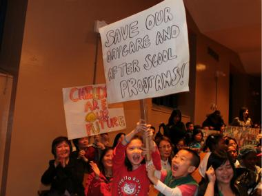 Hundreds of people chanted and waved signs at a rally against after-school cuts May 3, 2012.
